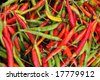 Organic chili pepper assortment at farmer's market - stock photo