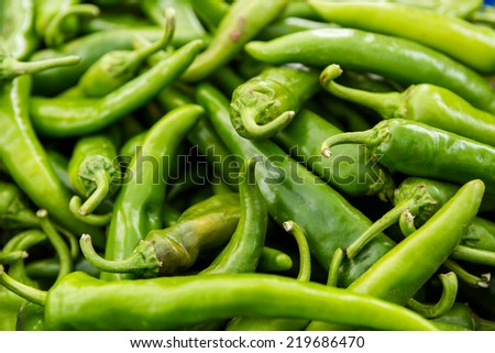 Organic chilli peppers at the local farmers market. - stock photo