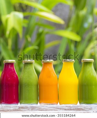 Organic cold-pressed raw vegetable juices in glass bottles - stock photo