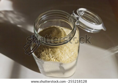 Organic cornstarch stored in a glass jar free of plastic chemicals - stock photo