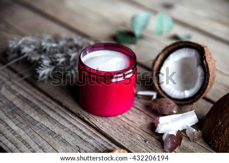 Organic cream on wooden background. Conditioner, shampoo for hair care. Natural cosmetics. Healthy skin and hair.