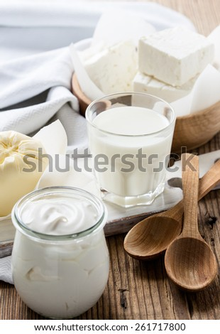 Organic dairy products on rustic wooden table. Cheese, milk, butter, sour cream