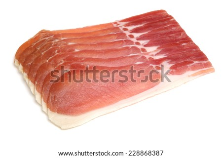 Organic dry-cured back bacon on white background.