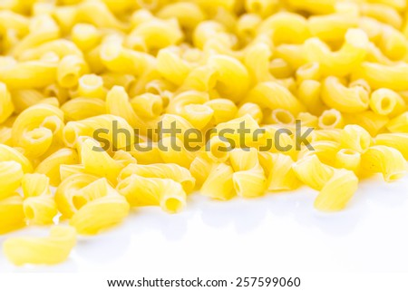 Organic dry pasta on a white background.