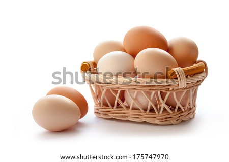 Organic eggs in the basket on the white background