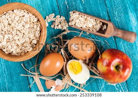 Organic eggs on blue wood background. - stock photo