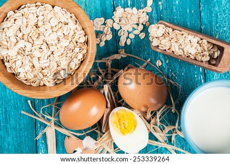 Organic eggs on blue wood background. - stock photo