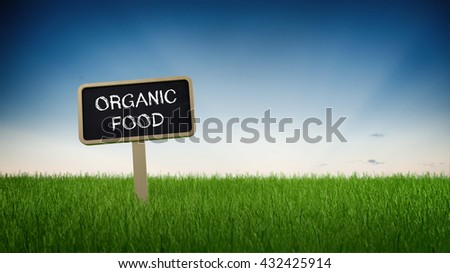 Organic food advertising text in white chalk on blackboard sign in flowing green grass under clear blue sky background. 3d Rendering.  - stock photo