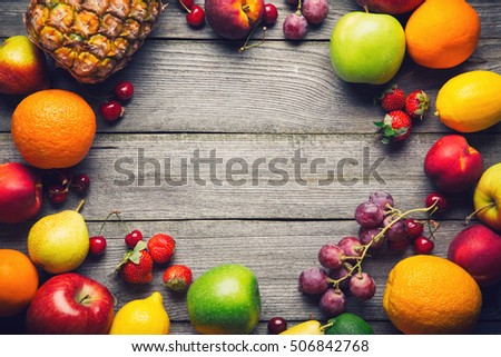 Organic food background. Food photography different fruits on wood background. Copy space.