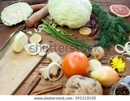 Organic food. Organic vegetables on a wooden surface. Onions, potatoes, carrots, green onions, dill, ginger, tomato, pepper. Rustic style. A realistic view of vegetables. Harvest with an organic farm. - stock photo