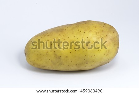 Organic fresh potatoes in net package from supermarket on white background in studio lighting.