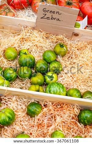Organic fresh tomatoes from mediterranean farmers market. Healthy local food market. - stock photo