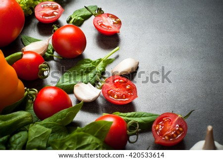 Organic fresh vegetables at slate background. Healthy eating and Diet concept.  Vegan food background.