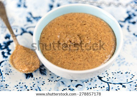 Organic Freshly Made Almond Butter in Small Serving Bowl - stock photo