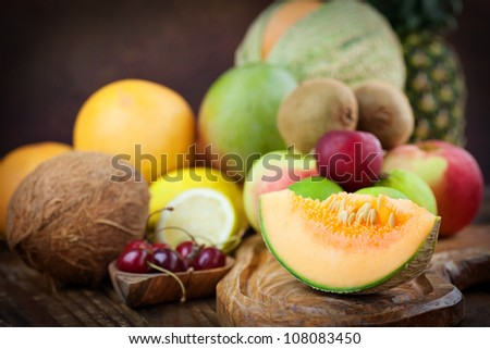 Organic Fruit variety on wood. Tropical exotic food concept. - stock photo