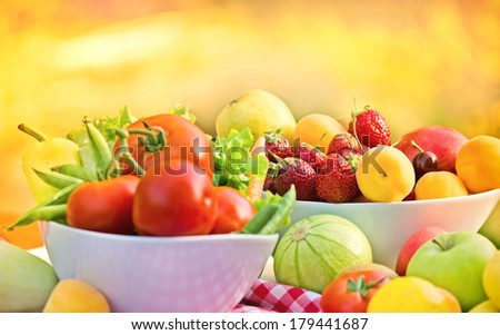 Organic fruits and vegetables in a bowls