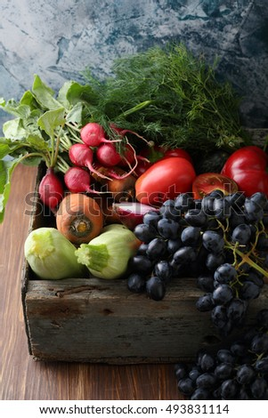 Organic fruits and vegetables in crate, food closeup