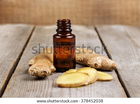 Organic ginger essential oil - stock photo