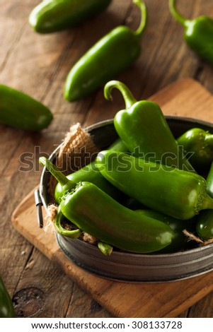 Organic Green Jalapeno Peppers in a Bowl - stock photo