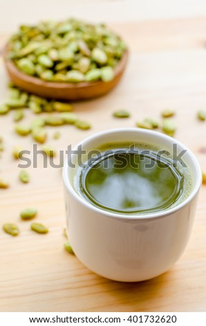 Organic Green Matcha Tea and edible seeds of hyacinth bean snack