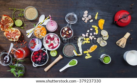 Organic Green Matcha Tea, blue acai berries, buckthorn berry smoothie bowl with superfood ingredients, , Clean eating breakfast concept, top view, wooden table, rustic styleon wooden table, top view - stock photo
