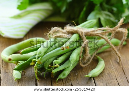 organic green peas on a wooden table, rustic style - stock photo