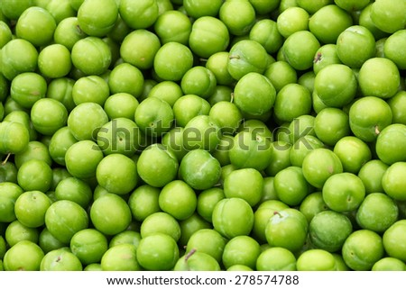 Organic green plums together in a farmers market..  - stock photo