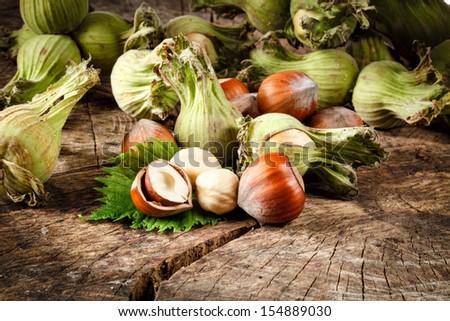 Organic hazelnut on wooden table - stock photo