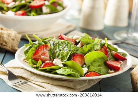 Organic Healthy Strawberry Balsamic Salad with Spinach - stock photo