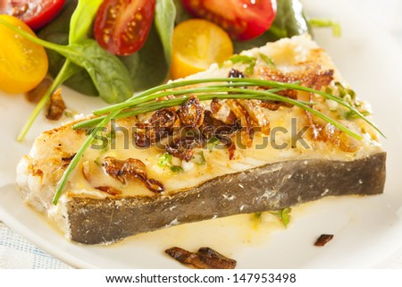 Organic Homemade Grilled Halibut Fish with a Salad - stock photo