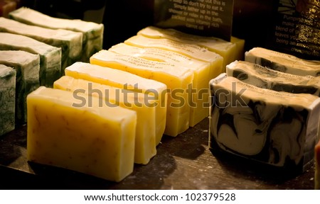 organic homemade herbal soaps on the market - stock photo