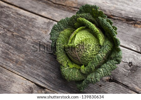 Organic kale on a rustic wooden board - stock photo
