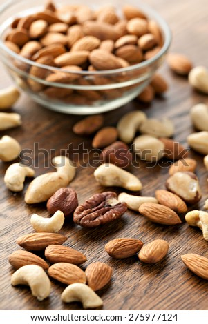 Organic mixed nuts in raw form unroasted and unsalted.  Close up macro still life with a shallow depth of field. - stock photo