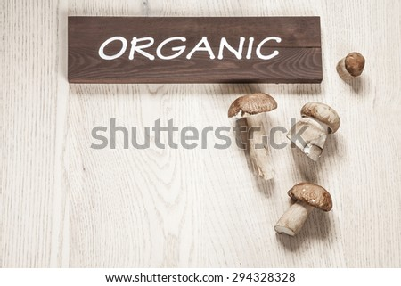 Organic mushrooms on the wooden table