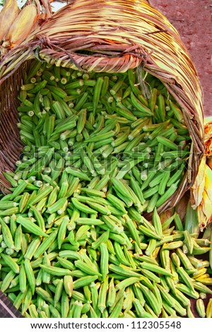 Organic Okra Spilling From A Basket  At A Street Market (Lady Fingers) - stock photo