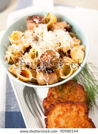 Organic Pasta Shells Served with Ground Beef, Cheese and Potato Pancakes