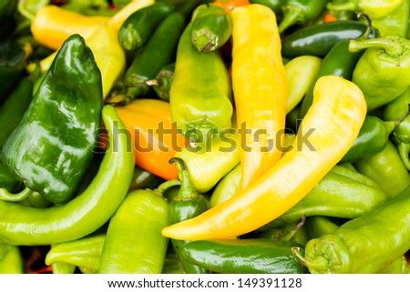 Organic peppers in a pile at the local farmer's  market. - stock photo