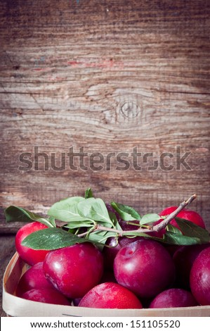 organic plums fruit  on a wooden background