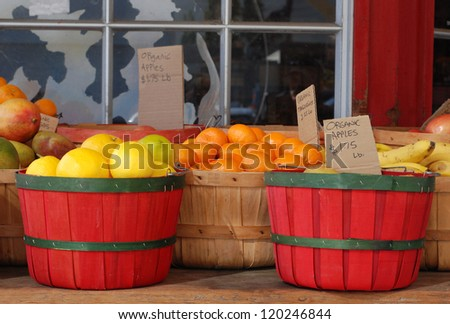 Organic produce in baskets, for sale outdoors - stock photo