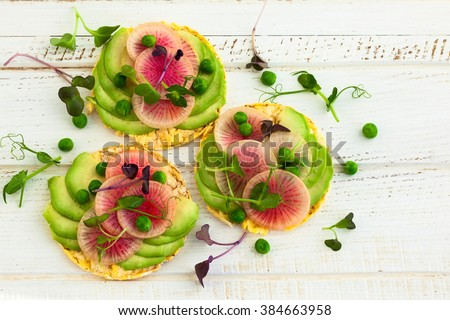 Organic quinoa cakes with avocado and watermelon radish for breakfast - stock photo