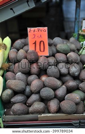 Organic Raw Green Avocados Sliced in Half - stock photo