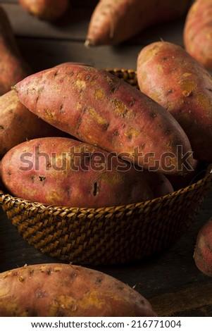 Organic Raw Sweet Potatoes on a Background - stock photo