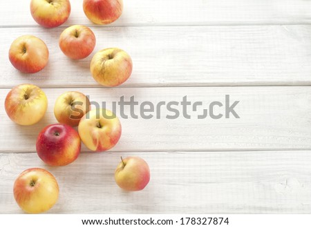Organic Red Akane Apples, Sweet and Tart Fresh Picked from the Tree on White Wood Boards for a Background with Room or Space for copy or your words or text.   Top view looking down from above. - stock photo