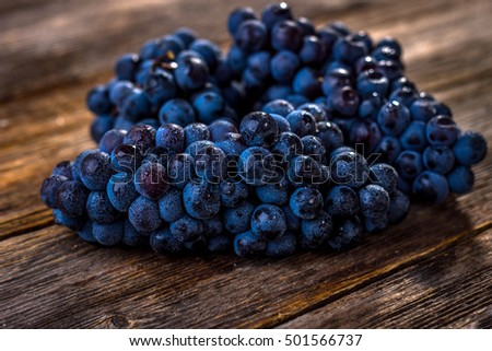 Organic  red grapes on  old wooden table.