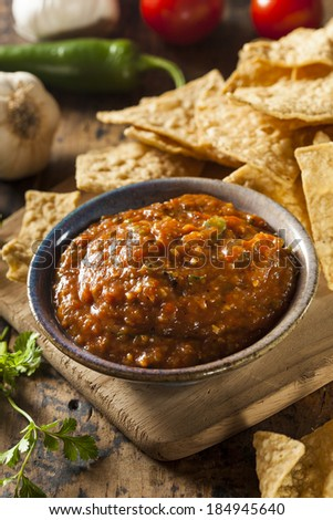 Organic Red Spicy Salsa with Tortilla Chips - stock photo