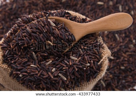 Organic Riceberry with wood spoon