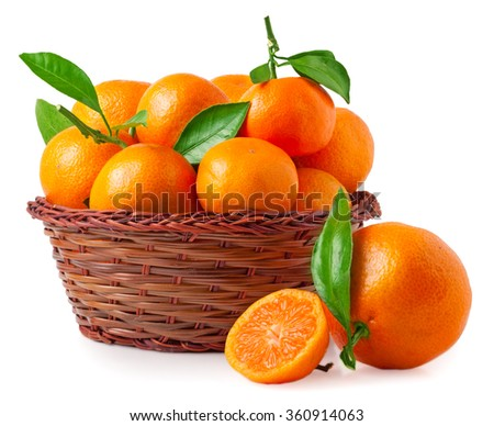 organic ripe mandarins in basket on white background
