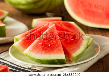 Organic Ripe Seedless Watermelon Cut into Wedges - stock photo
