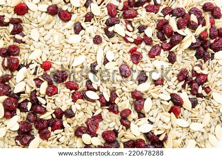 Organic seeds and dried cranberries in a Muesli. - stock photo