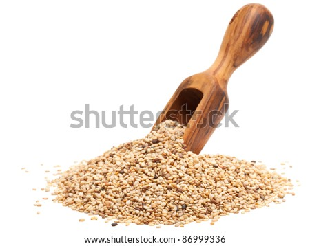 Organic sesame seeds with wooden scoop over white background - stock photo